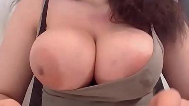 Slutty milf showing boobs with milk on cam